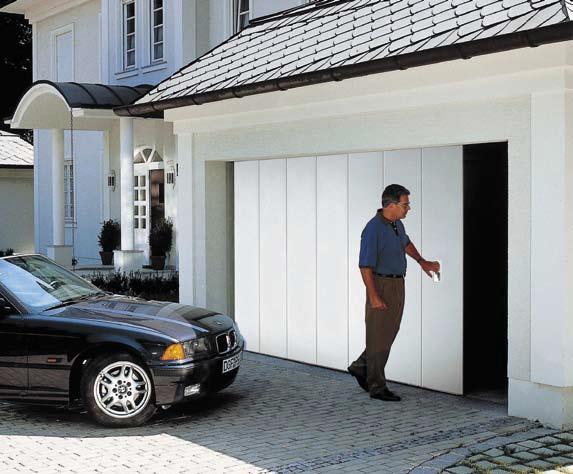 how to manually open merlin garage door