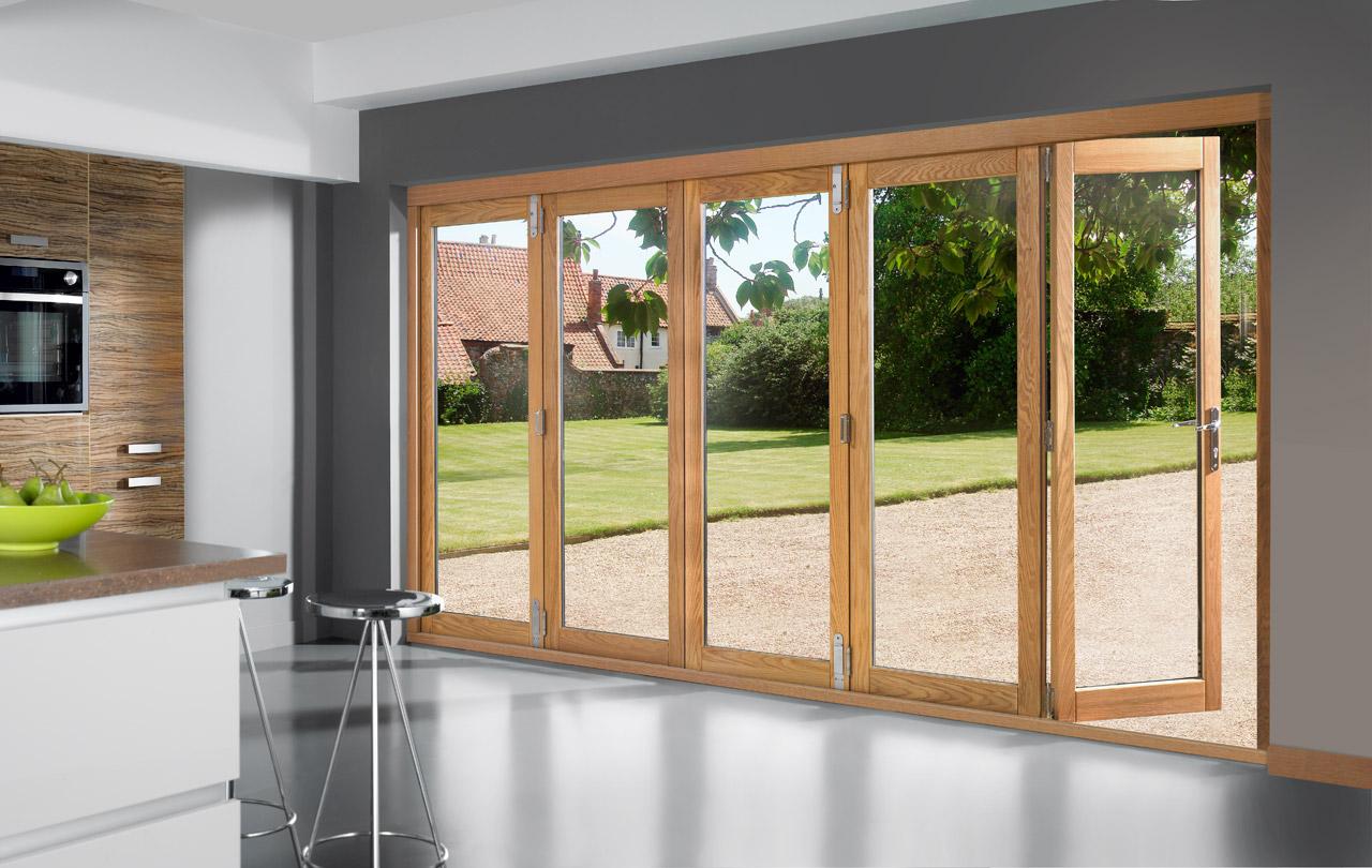 Wooden folding door bi fold dia home mediniai pvc for Hardwood patio doors