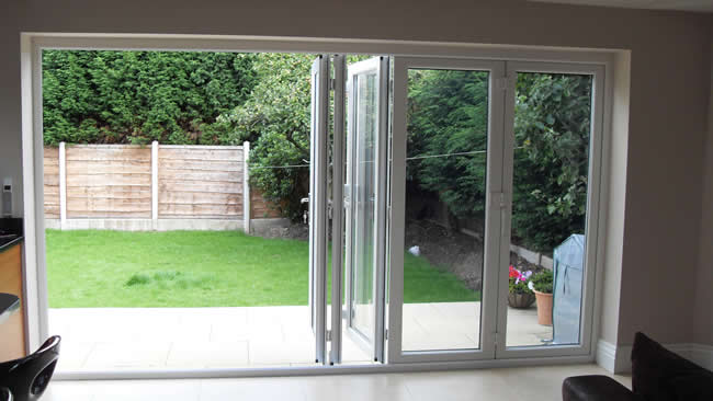 Tri fold patio doors reliabilt in lite glass primer white for Folding french patio doors